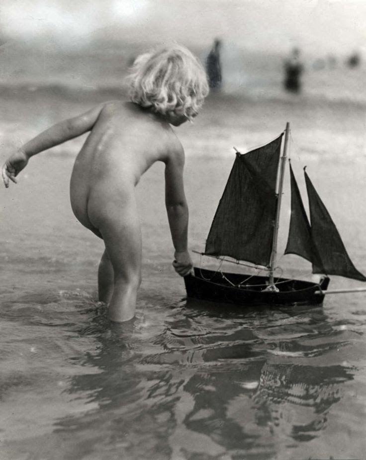 playing with toy sailboat | 1932