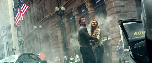Cade Yeager (Mark Wahlberg) and his daughter Tessa (Nicola Peltz) brace for an attack by Decepticons in TRANSFORMERS: AGE OF EXTINCTION.