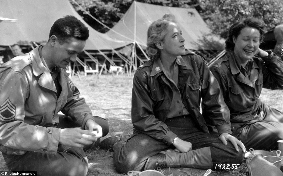 Socialising: On August 1, 1944 a sergeant spends time with two members of the U.S. Women's Army Corps