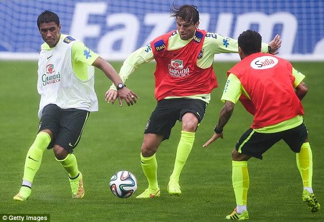 Surprise inclusion: Henrique (centre) was a shock choice for Brazil's at centre back