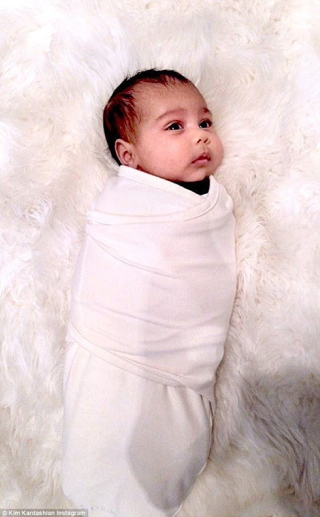 Flashback: North as a baby; family friend Malika Haqq thinks the infant looks like his older sister