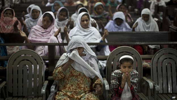 Pakistani Christian worshippers, some of them who survived Sunday's suicide bombing, pray during a special mass for the victims of the bombing, at the Church where the attack took place, in Peshawar, Pakistan.