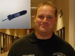 PHOTO: Bomb Squad Sgt. Robert Whitley received a Medal of Valor for acting quickly to remove an IED from a patients neck.