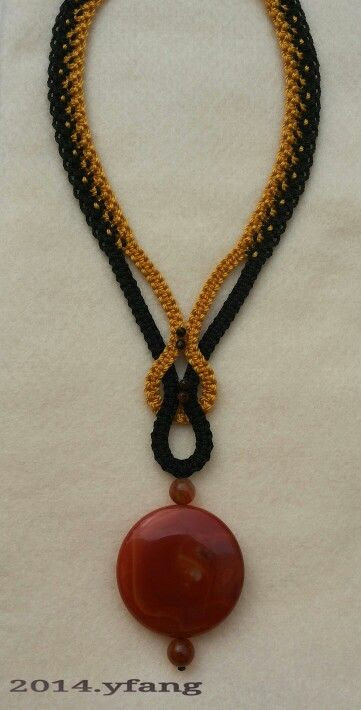 Black and gold macrame necklace with carnelian stones