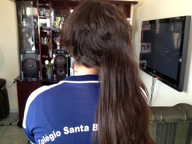 Menina disse que teve cabelo cortado com tesoura por duas garotas em Macapá (Foto: Abinoan Santiago/G1)