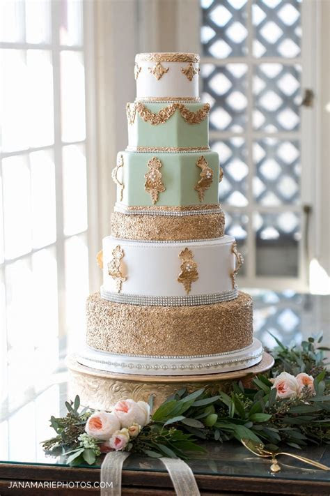 Gold, ivory and mint wedding cake with confetti and bling