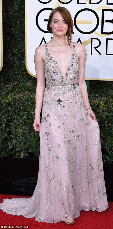 Twinkle twinkle! LaLa Land's Emma Stone wore a star-embellished gown, to collect her Best Performance by an Actress in a Motion Picture Musical or Comedy gong - one of seven won by the record-breaking movie