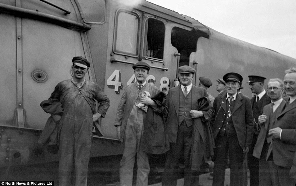 Full 'team' ahead: The crew of the Mallard at Peterborough after their world record-breaking feat in 1938