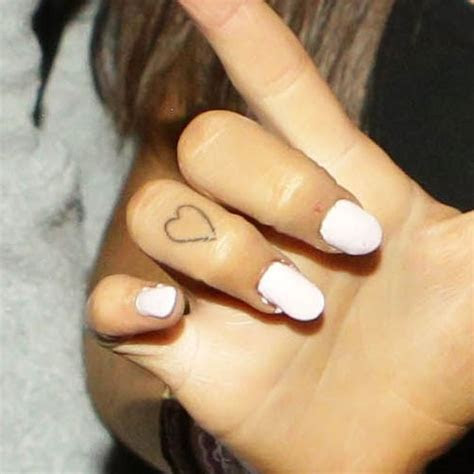 ariana grandes tattoos meanings steal style