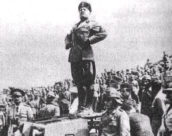 http://upload.wikimedia.org/wikipedia/en/a/ad/Mussolini_standing_on_a_tank.jpg