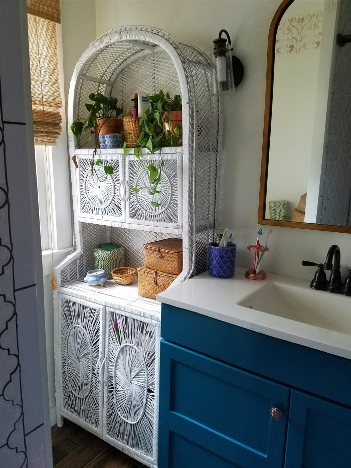 bohemian bathroom decorating and renovation: blue vanity and wicker cabinet