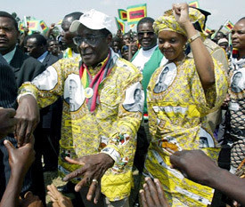 President Robert Mugabe of Zimbabwe with First Lady Grace Amai at a ZANU-PF rally.  The nation of Zimbabwe celebrated 29 years of national independence on April 18, 2009. by Pan-African News Wire File Photos