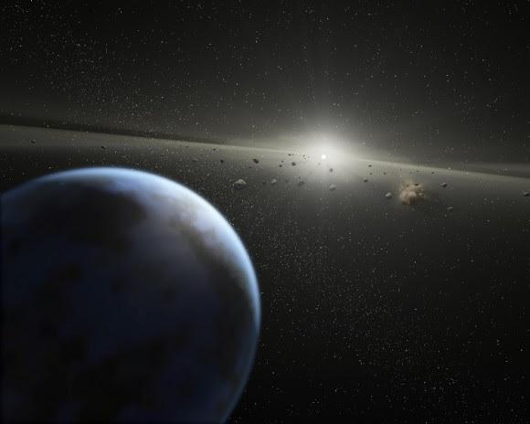 Artist's impression of a massive asteroid belt in orbit around a star. Credit: NASA-JPL / Caltech / T. Pyle (SSC)