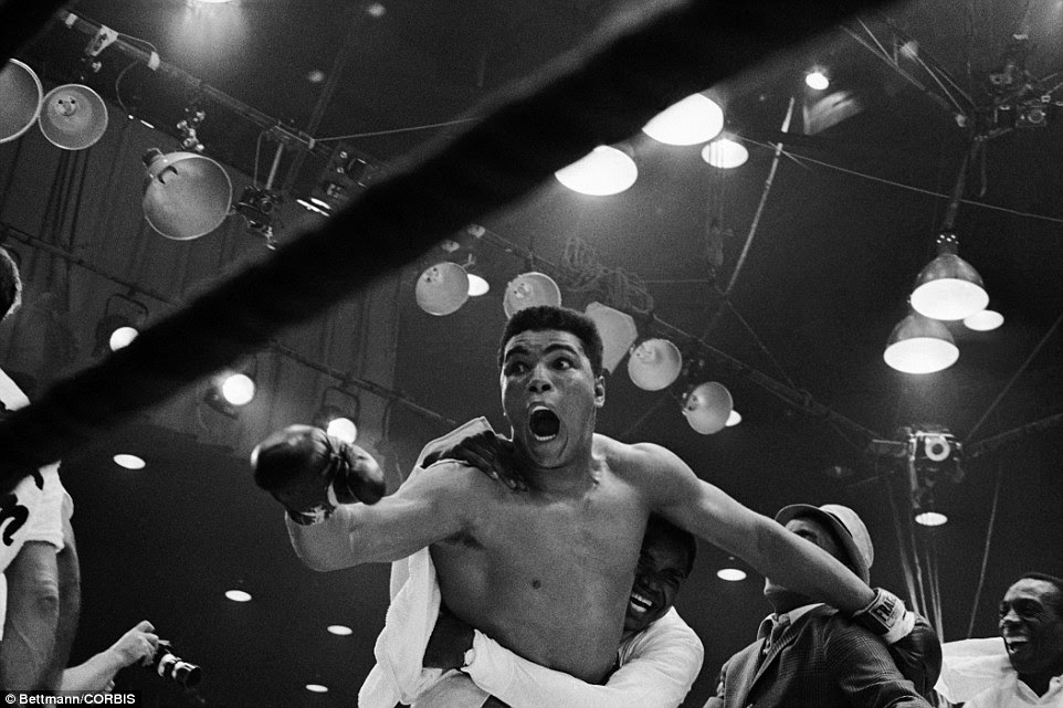 Ali's delight is all too obvious as he celebrates victory over Liston and is mobbed by his support team at the end of the fight