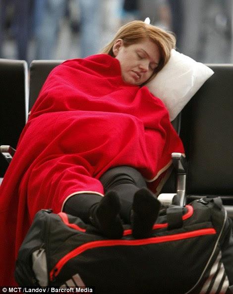 Stranded passengers sleep in the International Terminal at San Francisco International Airport on July 7, 2013, in San Francisco, California