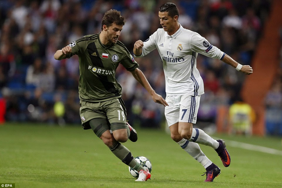 Ronaldo jinks past with Legia defender Bartosz Bereszynski during the first half of their Champions League group clash
