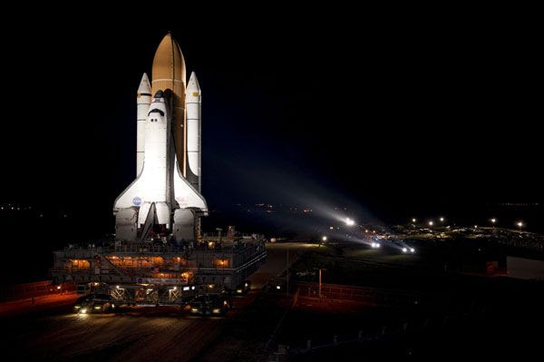 Space shuttle Atlantis rolls out of the Vehicle Assembly Building at Kennedy Space Center in Florida on May 31, 2011.