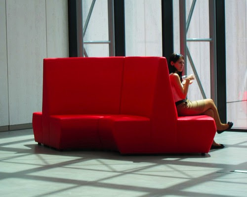 a red sofa by Anna Amnell