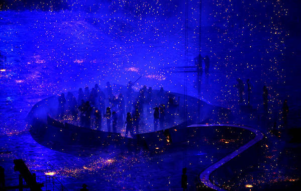 Performers take part in the opening ceremony of the London Olympics on Friday.