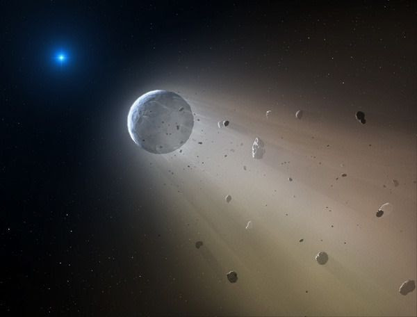An artist's concept of a rocky object, discovered by NASA's Kepler spacecraft, being torn to pieces by a white dwarf star.