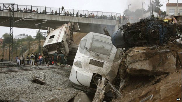 Overturned carriages of derailed train near Santiago de Compostela, Spain, on 24 July 2013