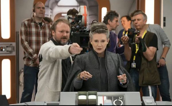 Rian Johnson directs the late Carrie Fisher on the set of STAR WARS: THE LAST JEDI.