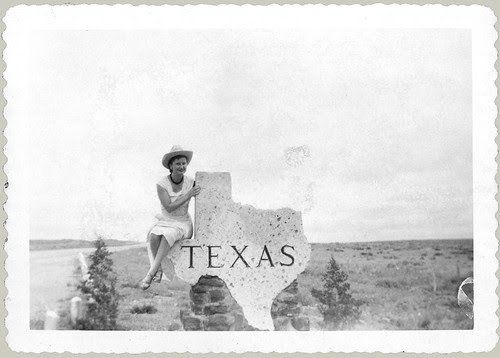 Sitting on a Texas Sign