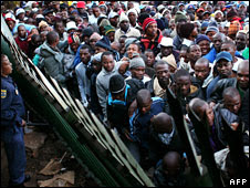 Migrants, most of them from Zimbabwe, at an entrance of a refugee centre in Johannesburg in 2008