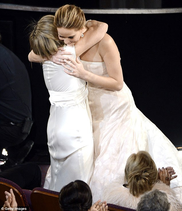 Thats' our girl! Jennifer's mother Karen hugs her as her triumph is announced