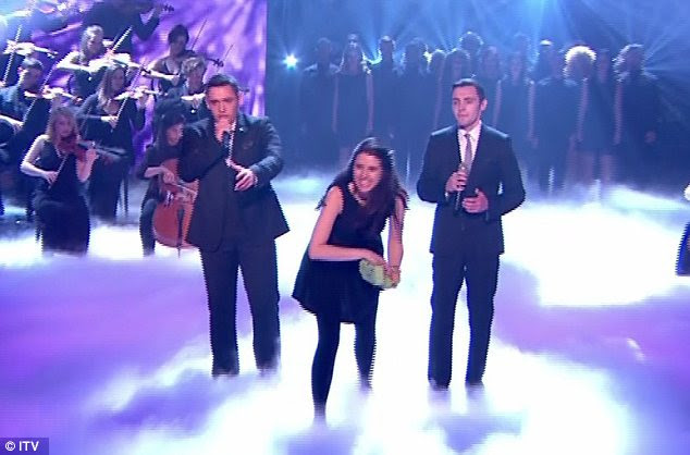 What on earth? Natalie Holt had been performing in the band when she got up and threw eggs at Simon Cowell