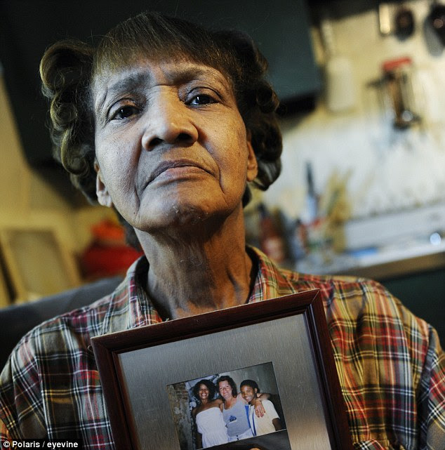 Loss: Sandy Drain holds a picture of Gloria Walker who was identified as one of Anthony Sowell's victims