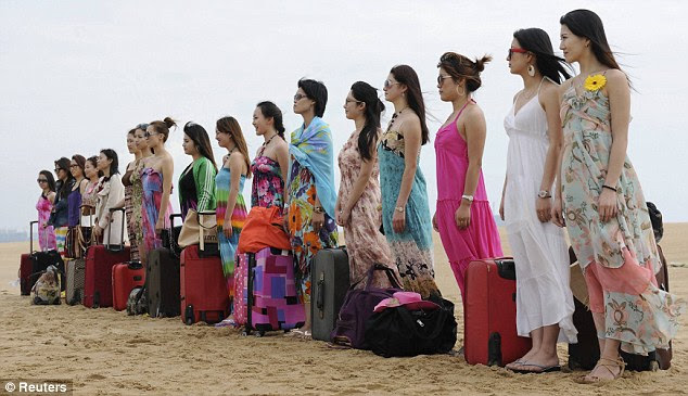 Glamorous: The women, many of them college graduates, line up before the start of the training session. Demand for female bodyguards has risen sharply in China as they booming economy as made wealthy business people look to their own security