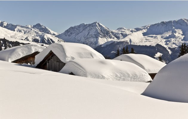 Huts are covered with snow on  Maiensaess Lafet mountain above Castiel, Switzerland,  Monday Feb. 6, 2012.  Europe was hit by a cold spell with temperatures plummeting far below the freezing point.  (