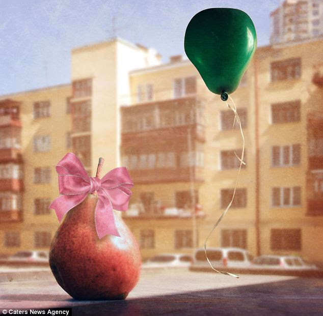 Baby pear: The fruit is dressed in a young girl's pink ribbon and pictured with a green balloon
