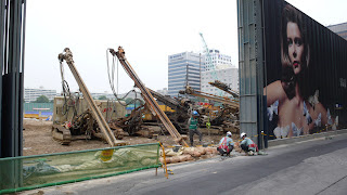 IFC Seoul construction site, with hoardings and drilling machines