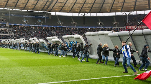 Fake 'Berlin Wall' dismantled by German soccer fans before match