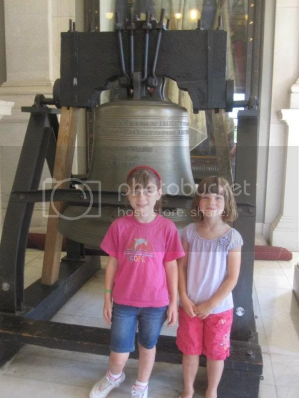 Emma and Jenna in front of the Pass & Stow bell