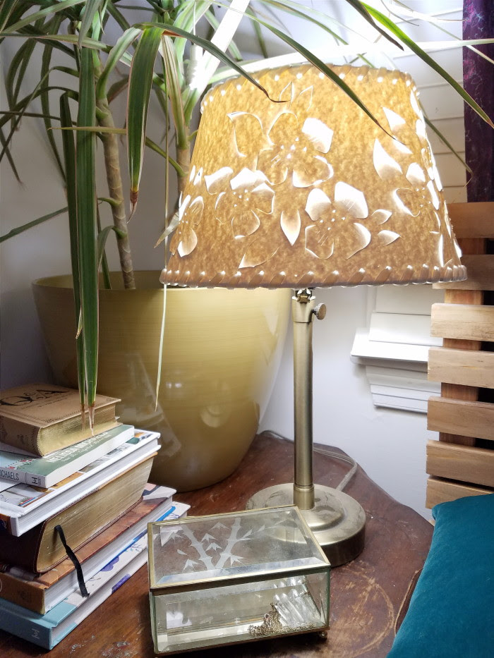 Perforated lamp shade flower design