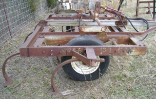 Side View of 9 Point Chisel Plow