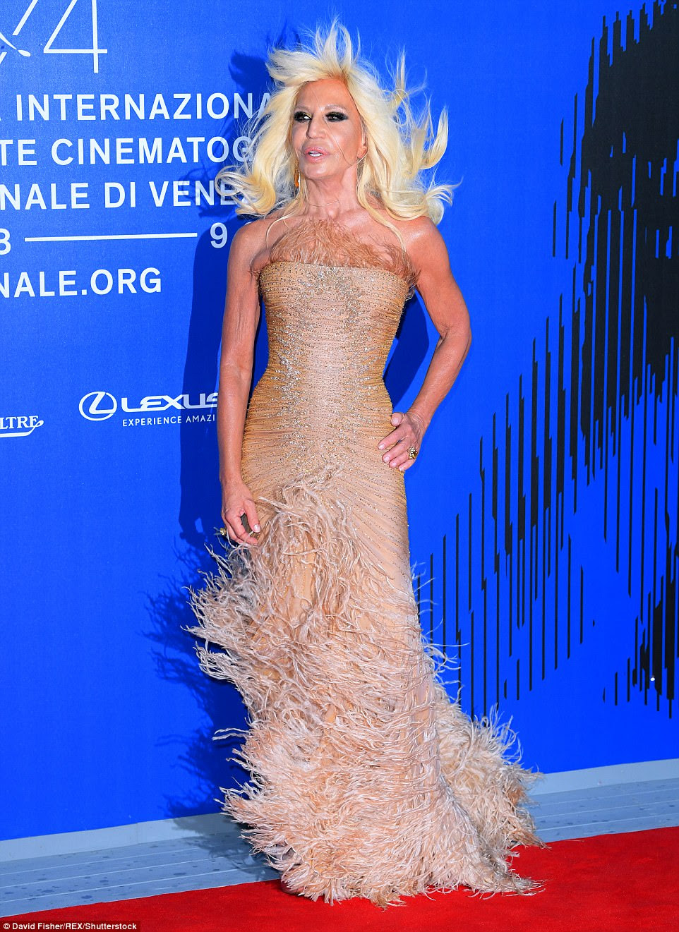 Show-stopping: Donatella Versace, 62, also stole the show in a nude bodycon fishtail gown