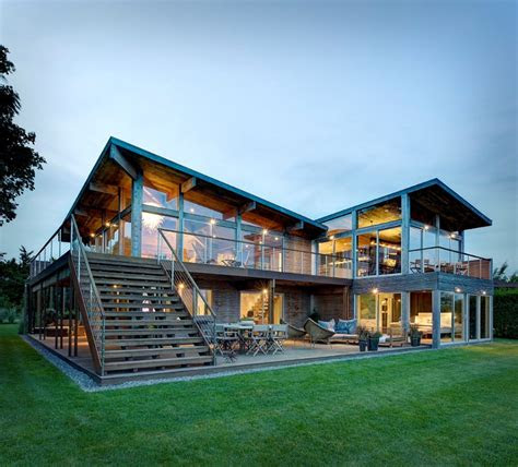earthy timber clad interiors  urban glass exteriors