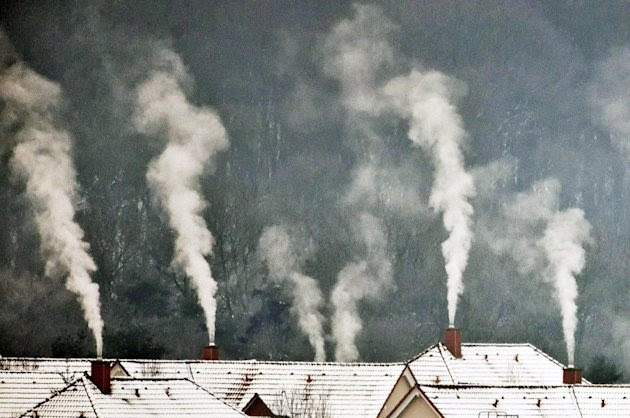 Smoke rises from chimneys on a cold winter morning near Weimar, central Germany, Tuesday, Feb. 7, 2012. A cold spell has reached central and eastern Europe with temperatures far below zero. (AP Photo/