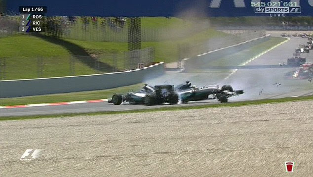 Hamilton's Mercedes collided with his team-mate's car and both slid onto the gravel on the side of the track