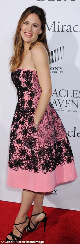 Preppy princess: The Golden Globe winner - who turns 44 next month - looked girly in her strapless, pink lacy floral full-skirted frock and black stilettos selected by stylist Rachel Zoe