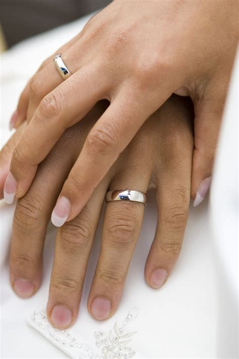 holding hands with wedding rings   ZION SPA