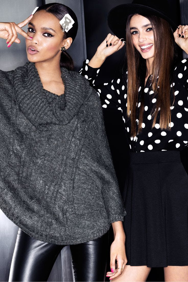 Gray knit poncho and black & white long-sleeve polka-dot blouse. #HMDIVIDED