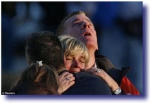 sandy hook parent grieving 300x207 Gun Control   Is It The Solution?