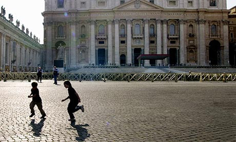 Children play in St Peters' Square at the Vatican.