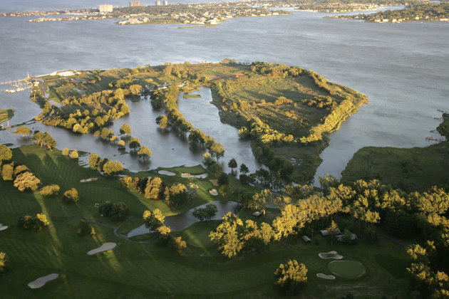 ADDS NAME AND LOCATION OF GOLF COURSE - Large sections of the golf course at Rumson Country Club in Rumson, N.J.  are flooded by Hurricane Irene Sunday, Aug. 28, 2011. (AP Photo/Rich Schultz)