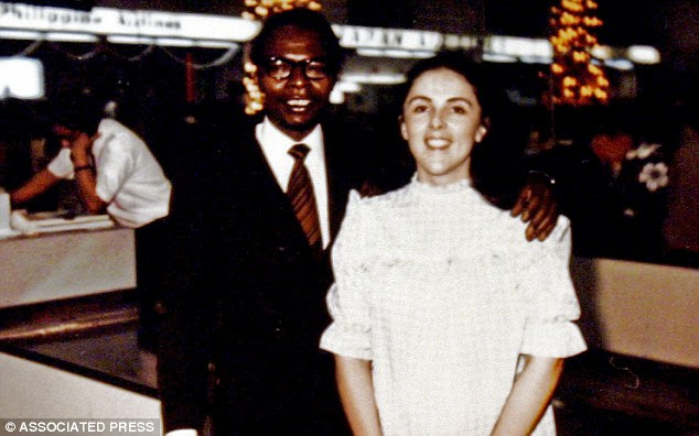 Happier times: Barack Obama senior stands with the President's mother Stanley Ann Dunham at an airport in Hawaii